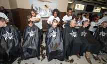 Several kids getting haircuts at the Share a Haircut Event