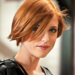 woman with short fall red hairstyle