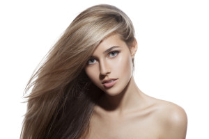 Beautiful Blond Girl. Healthy Long Hair. White Background