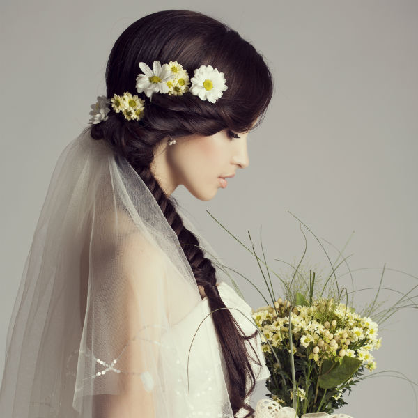 young bride with flowers and long side braid