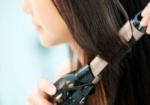 Woman using curling iron