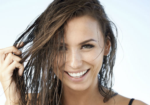 Woman smiling with wet hair