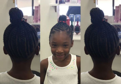 African american young girl with cornrows into ballerina bun