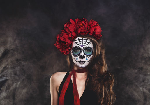 Skeleton makeup with side swept hair and red flowers