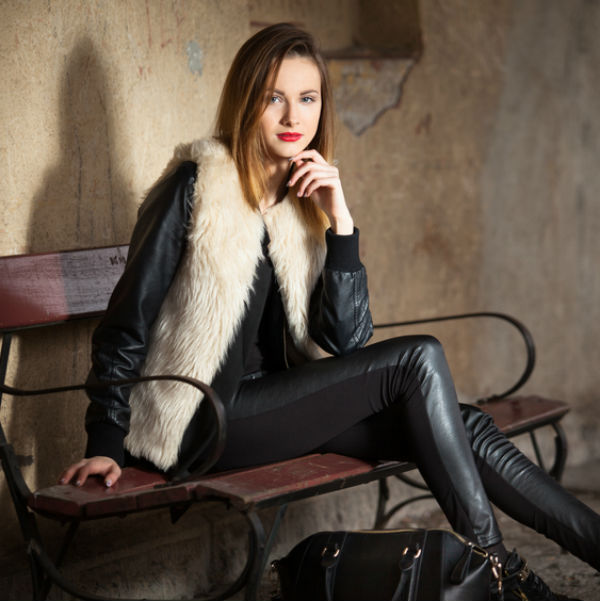 Woman with ombre hair and fur vest in leather outfit