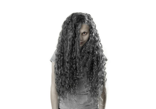 Long wet hair combed over face