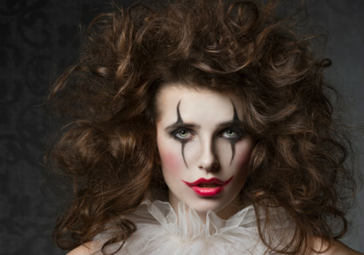 Woman with clown makeup and messy curly hair