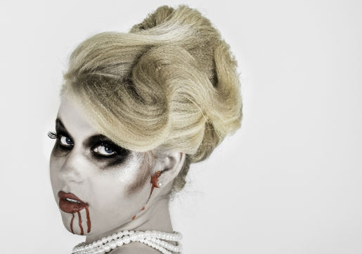 Young girl with zombie makeup and an updo