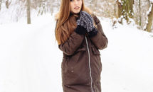 Young woman with long light brown hair in the snow