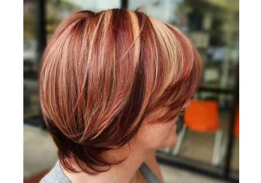 long pixie cut with red highlights