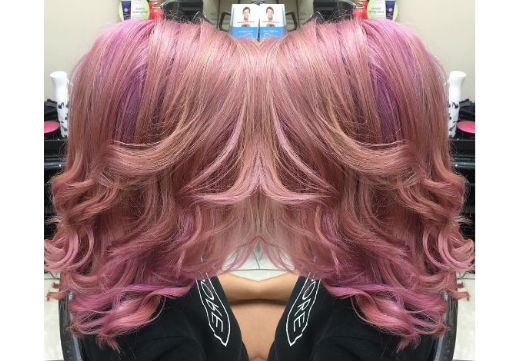 medium length pink hair with curls