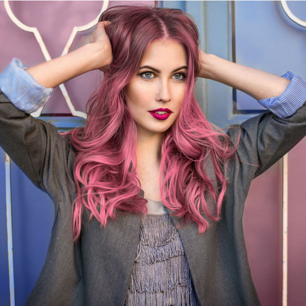 Young woman with bright pink hair