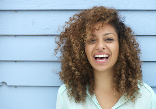 Young woman with natural curly hair
