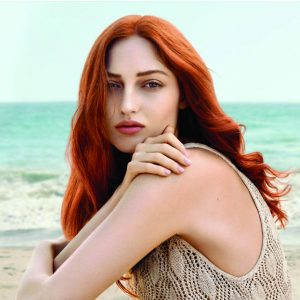 Redhead on beach
