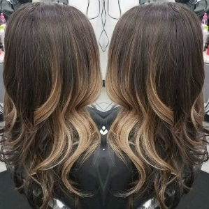 Brunette hair with blonde balayage highlights from Hair Cuttery