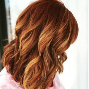 Redhead with blonde balayage highlights from Hair Cuttery