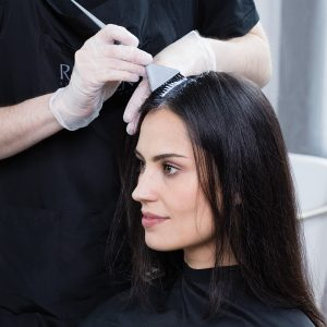 Color-treated hair tips Woman getting hair coloring service at Hair Cuttery