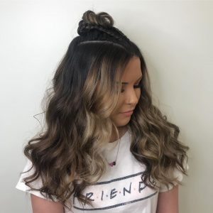 Braids into top bun with long hair down for prom from Hair Cuttery