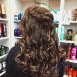 Half updo with braid into bun with curls for prom from Hair Cuttery