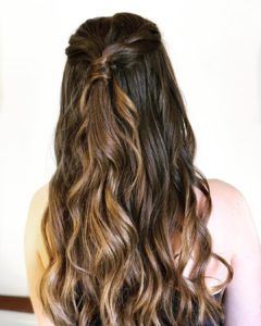 Half updo with loose waves for prom from Hair Cuttery