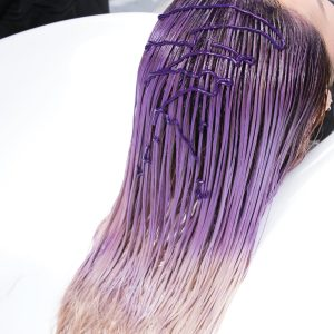 Purple Toning haircare woman with shampoo in salon sink