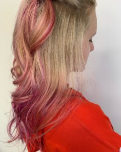 Hair Color Guide in your 20s girl with blonde hair and pink balayage hair color
