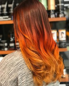 fall hair trends- vivid red and yellow balayage on long hair