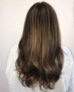 Single Process haircolor highlights on virgin brunette hair