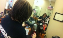 stylist blow drying customers hair