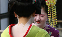 Asian woman fully dressed in geisha attire