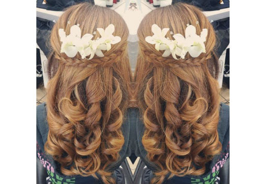 Half up do with white flowers