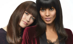 two women with long straight hair and heavy bangs